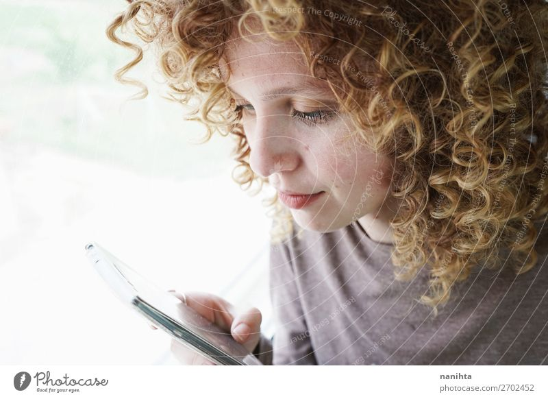 portrait of a young woman looks at her smartphone Woman Human being Youth (Young adults) Beautiful Relaxation Calm 18 - 30 years Face Adults Life Natural