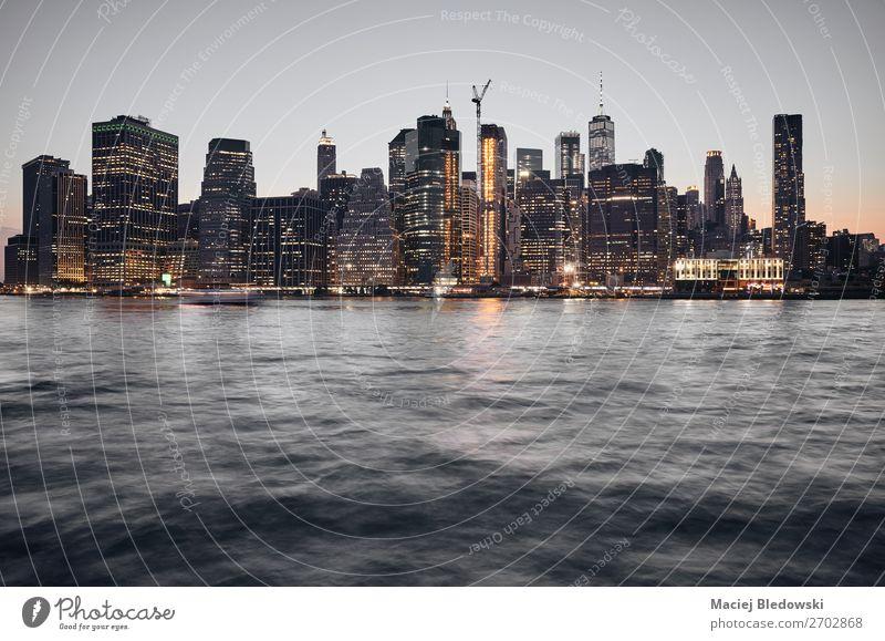 Manhattan skyline at sunset, New York. Sky River Town Downtown Skyline High-rise Building Architecture Dark Business Financial Industry Money Society