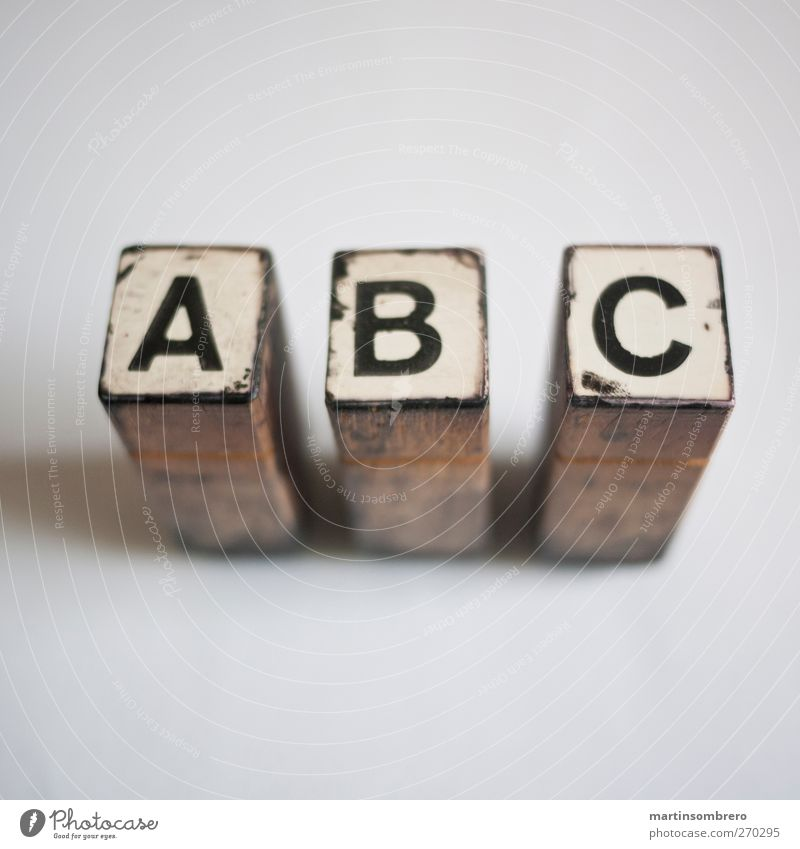 """A B C"" Stamp Wood Sign Characters Digits and numbers Old Esthetic Brown Black White Calm Study Know Printing Print shop Colour photo Subdued colour"