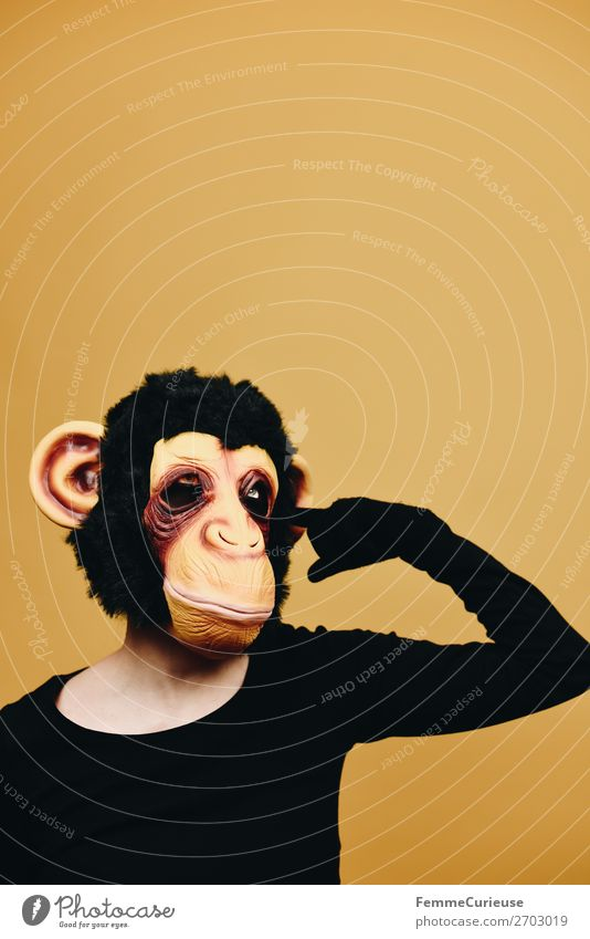 Person with monkey mask drilling in ear 1 Human being Animal Joy Yellow Monkeys Chimpanzee Pelt Latex Ear Humanity Behavior Code of conduct Evolution Carnival