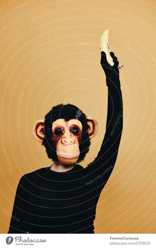 Person with monkey mask holding up a banana 1 Human being Animal Joy Monkeys Chimpanzee Costume Carnival Carnival costume Carneval masque Disguised Anonymous