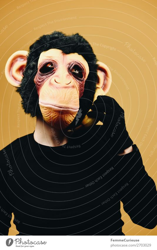 Person with monkey mask using banana as telephone 1 Human being Joy Communicate Telephone Cellphone Banana Telecommunications Monkeys Chimpanzee Mask Disguised