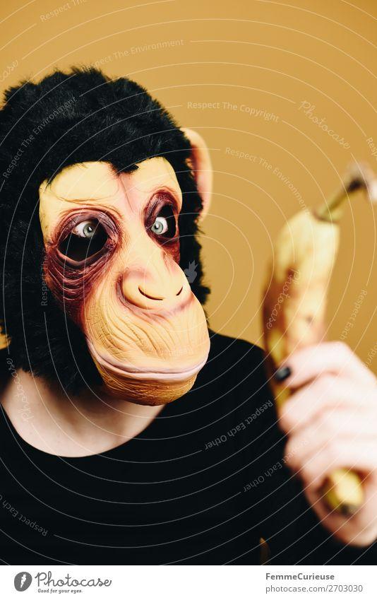 Person with monkey mask starring at banana Joy 1 Human being Nutrition Food Fruit Banana Evolution eating behaviour Monkeys Chimpanzee Carnival Carnival costume