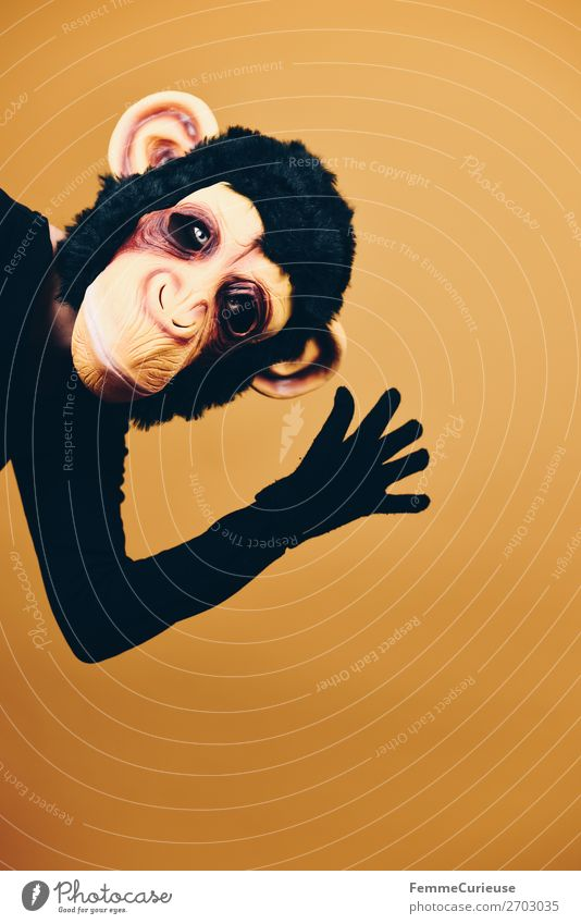 Person with monkey mask waving into the camera Joy 1 Human being Leisure and hobbies Carnival Carnival costume Dress up Monkeys Chimpanzee Mask Evolution