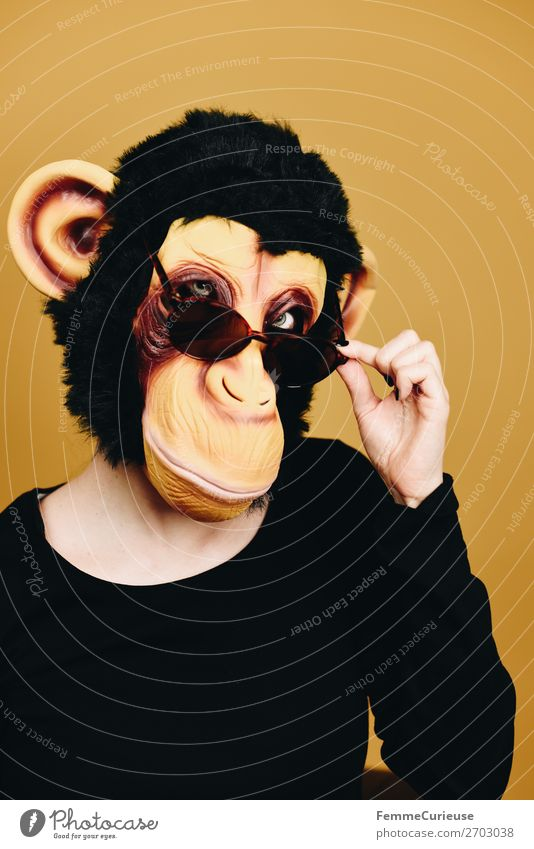 Person with monkey mask looking cool over sunglasses 1 Human being Animal Joy Cool (slang) Easygoing Anonymous Disguised Sunglasses Mask Monkeys Chimpanzee