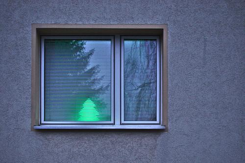minimal Christmas Wall (barrier) Wall (building) Facade Window Bright Fir tree Lamp Reflection Illuminate Christmas & Advent Green Roller blind Subdued colour