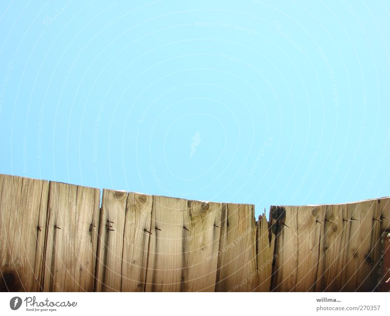 Old board fence with nails and lots of text space Cloudless sky Fence Wood Brown Turquoise Nail Freedom Deprivation of liberty Protection Screening Broken