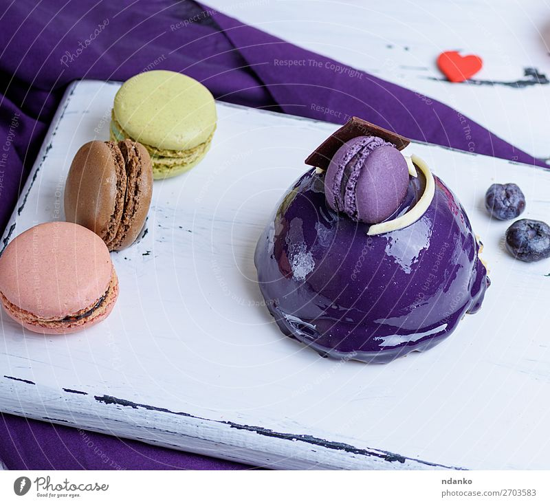 lilac round cake with macarons Dessert Candy Decoration Table Feasts & Celebrations Wood Small Delicious Blue Yellow White Colour background Bakery Berries