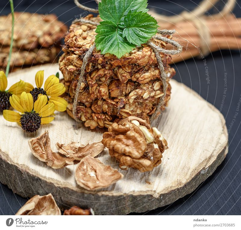 cookies made from oat flakes Cake Dessert Candy Nutrition Breakfast Lunch Diet Table Kitchen Flower Leaf Wood Delicious Natural Brown Yellow Black White Energy