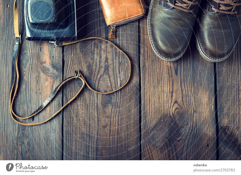 pair of leather brown shoes and an old vintage camera Style Design Camera Fashion Clothing Leather Accessory Footwear Wood Old Retro Brown Black Idea background