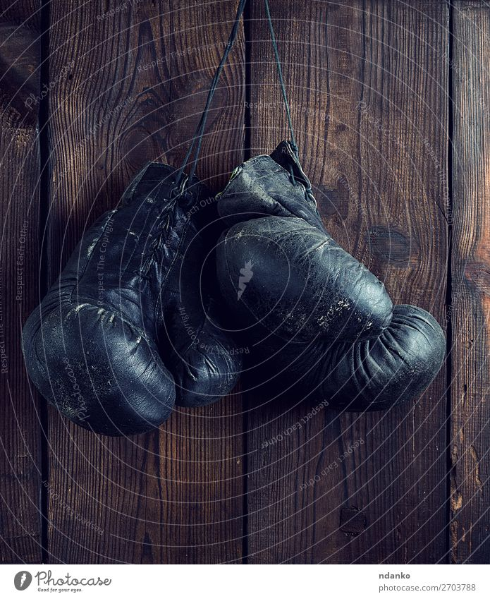old shabby black leather boxing gloves Old Black Lifestyle Wood Sports Brown Retro Dirty Action Fitness Rope Protection Athletic Hang Conceptual design Ancient