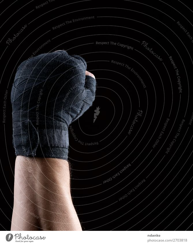 hand is wrapped in a black sports textile bandage Lifestyle Fitness Sports Track and Field Man Adults Hand Fingers 1 Human being 30 - 45 years Aggression Dark