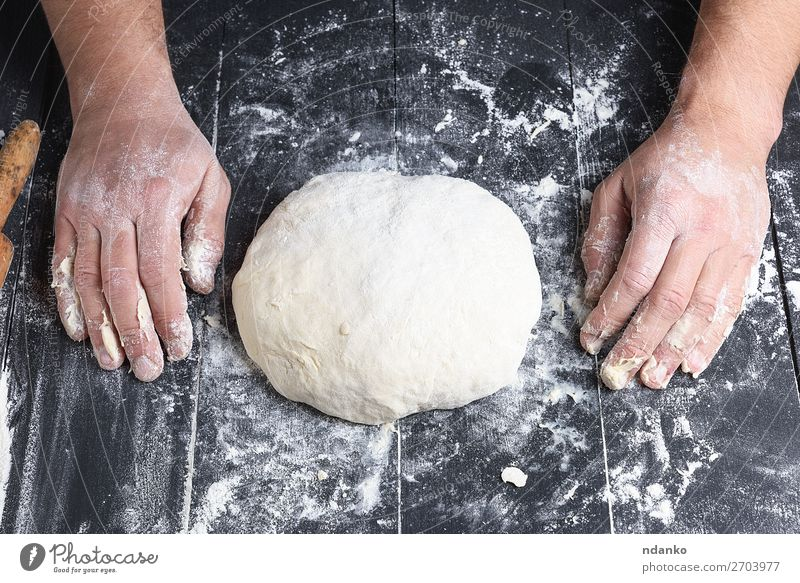 kneaded yeast dough made from white wheat flour Human being Man White Hand Black Adults Wood Nutrition Fresh Table Kitchen Baked goods Tradition Cooking Bread