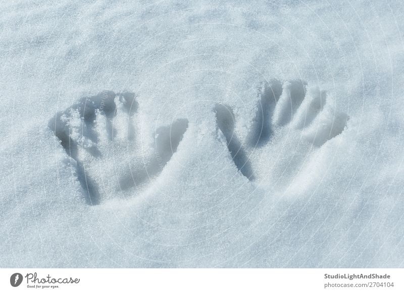 Handprints in the snow Playing Winter Snow Child Human being Infancy Art Animal tracks Simple Fresh White handprints palms two Tracks trace Imprint imprints