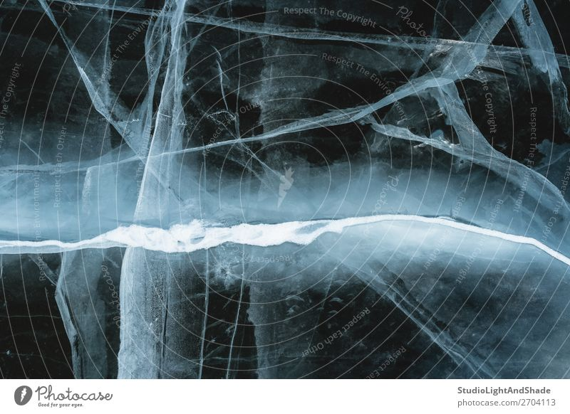 Cracked ice looking like a lightning Ocean Winter Snow Nature Lightning Glacier Lake River Crystal Ornament Line Freeze Dark Natural Black White Fear Mysterious