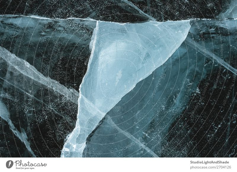 Triangular shape of cracked ice Ocean Winter Nature Glacier Lake River Crystal Line Freeze Fat Dark Natural Gray Black White Frozen Crack & Rip & Tear broken