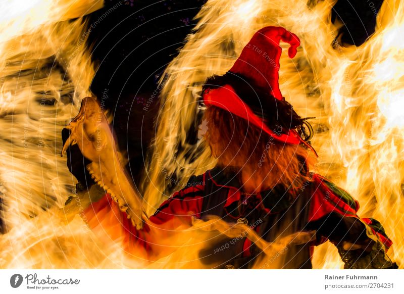 """a witch stands in a fire Human being Feminine Woman Adults 1 Art Stage play Theatre Actor Hat Movement Dance Creepy Historic """"Witch Fire Witch burning"""