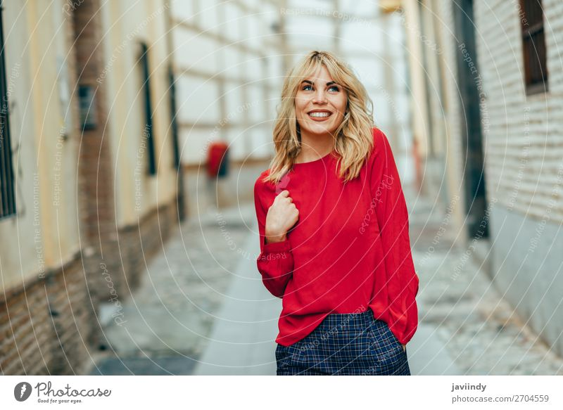 Happy young blond woman walking down the street. Lifestyle Style Beautiful Hair and hairstyles Human being Feminine Young woman Youth (Young adults) Woman