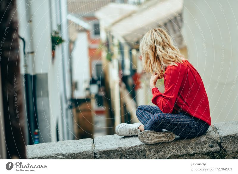 Young woman sitting outdoors looking a beautiful narrow street Lifestyle Style Happy Beautiful Hair and hairstyles Human being Feminine Youth (Young adults)