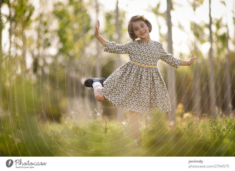 Little girl in nature field wearing beautiful dress Lifestyle Joy Happy Beautiful Playing Summer Child Human being Feminine Girl Woman Adults Infancy 1