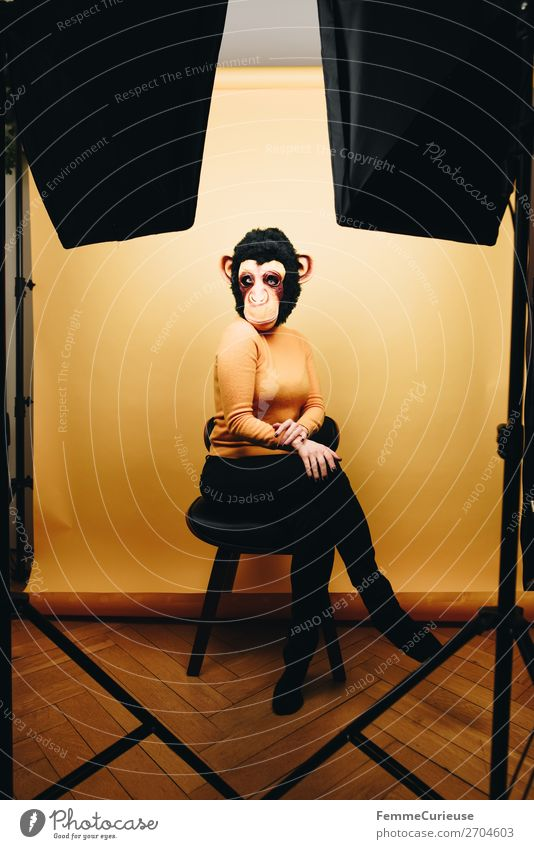Woman with monkey mask posing in photo studio Feminine Adults 1 Human being 18 - 30 years Youth (Young adults) 30 - 45 years Joy Photographic studio Studio shot