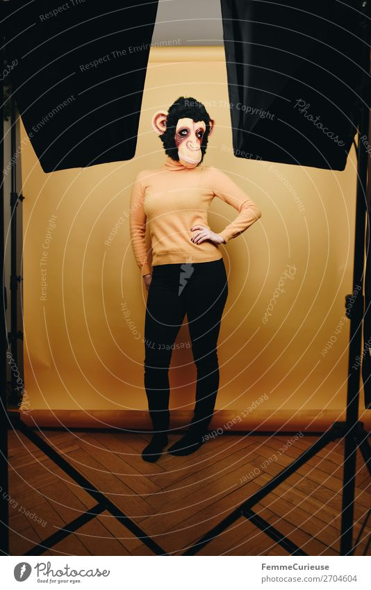 Woman with monkey mask posing in photo studio Feminine Adults 1 Human being 18 - 30 years Youth (Young adults) 30 - 45 years Joy Photographic studio Floorboards