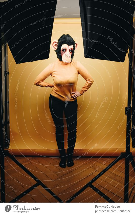 Woman with monkey mask posing in photo studio Feminine Adults 1 Human being 18 - 30 years Youth (Young adults) 30 - 45 years Joy Monkeys Chimpanzee Mask Pelt