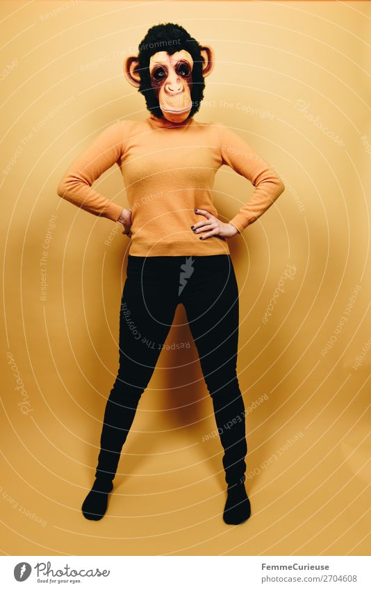 Woman with monkey mask posing against a yellow background Feminine Adults 1 Human being 18 - 30 years Youth (Young adults) 30 - 45 years Joy Carnival