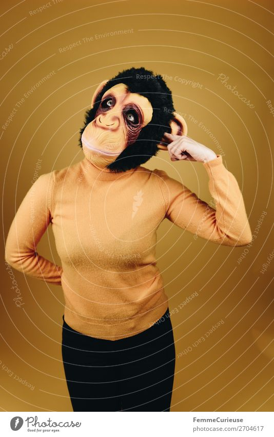 Woman with monkey mask drilling in her ear Feminine Adults 1 Human being 18 - 30 years Youth (Young adults) 30 - 45 years Joy Funny Ear Drill Touch Mask