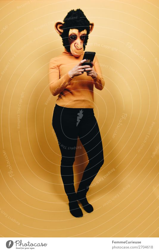 Woman with monkey mask looking at her smartphone Technology Entertainment electronics Feminine Adults 1 Human being 18 - 30 years Youth (Young adults)