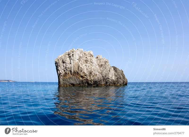 Rock in the surf Environment Nature Landscape Water Sky Cloudless sky Horizon Summer Beautiful weather Waves Coast Reef Ocean Stone Old Power Safety Protection