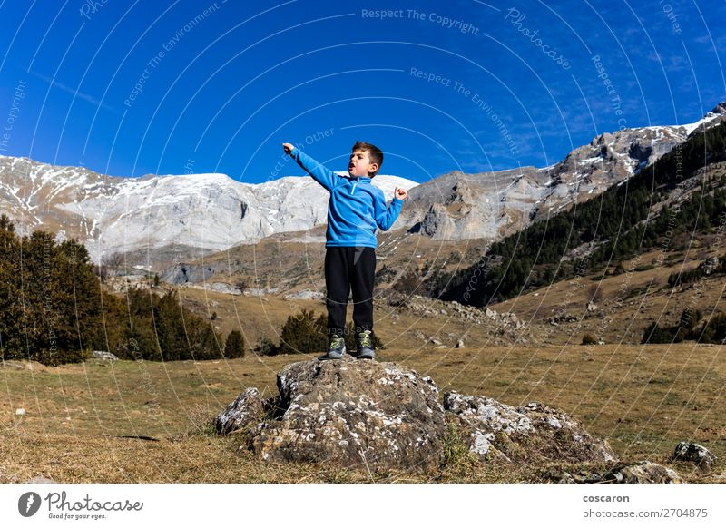 Little mountaineer on the peak of the mountains Joy Beautiful Leisure and hobbies Vacation & Travel Adventure Summer Winter Snow Winter vacation Mountain Hiking