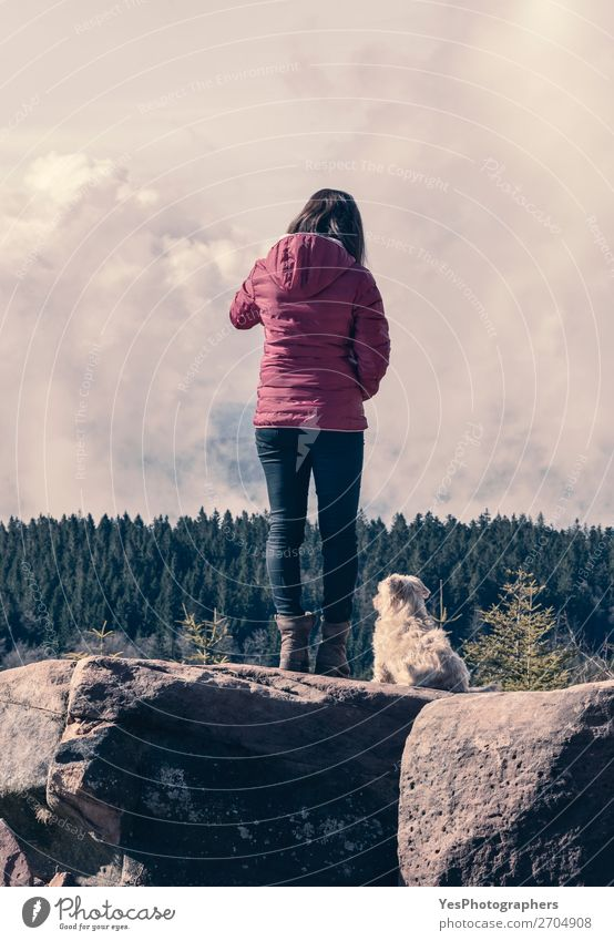 Millennial girl and her dog on mountain rocks Woman Human being Sky Vacation & Travel Nature Dog Youth (Young adults) Young woman Summer Landscape Relaxation