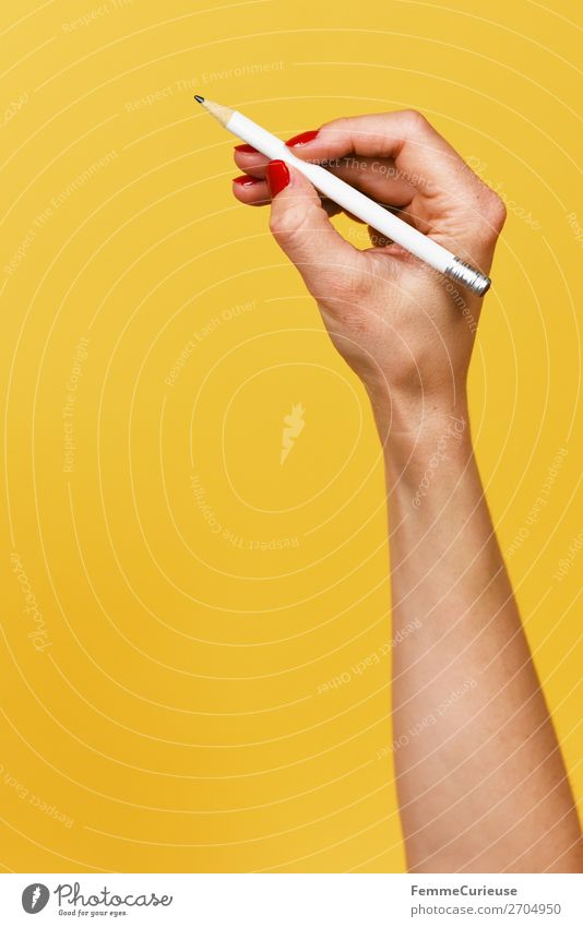 Forearm and hand with pencil against a yellow background Feminine Woman Adults 1 Human being 18 - 30 years Youth (Young adults) 30 - 45 years Creativity