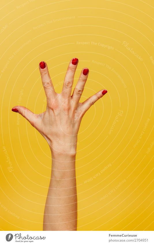 Forearm and hand with spread fingers against a yellow background Feminine Young woman Youth (Young adults) Woman Adults 1 Human being 18 - 30 years