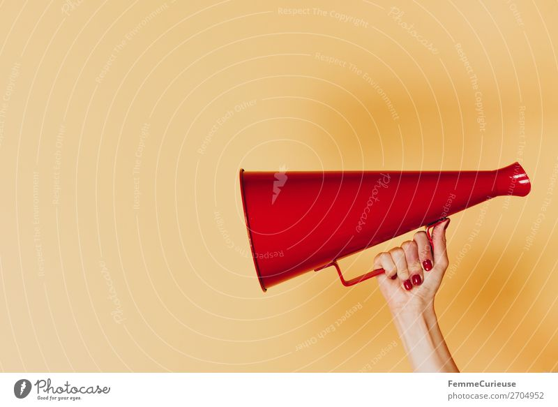 Female hand holding megaphone Feminine 1 Human being Communicate announcement Respect Signage Ready steady go Inform To talk Language Red Yellow Megaphone Hand