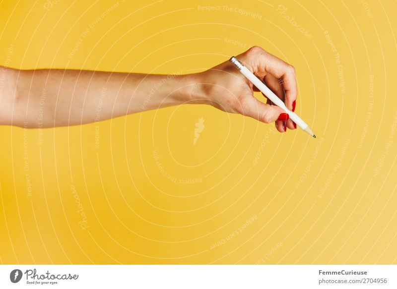 Forearm and hand with pencil against a yellow background Feminine Young woman Youth (Young adults) Woman Adults 1 Human being 18 - 30 years 30 - 45 years