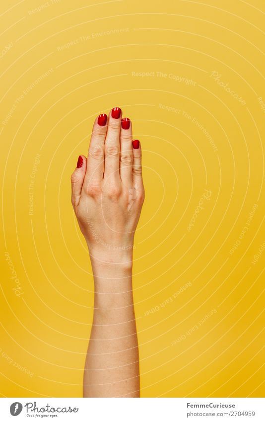 Forearm and hand of a woman in front of a yellow background Feminine Young woman Youth (Young adults) Woman Adults 1 Human being 18 - 30 years 30 - 45 years