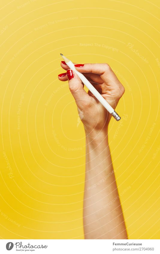 Forearm and hand with pencil against a yellow background Feminine 1 Human being Design Yellow Red Nail polish Pencil Write Writing Draw Hand Fingers Underarm
