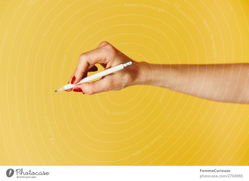Forearm and hand with pencil against a yellow background Feminine Woman Adults 1 Human being 18 - 30 years Youth (Young adults) 30 - 45 years Communicate Write