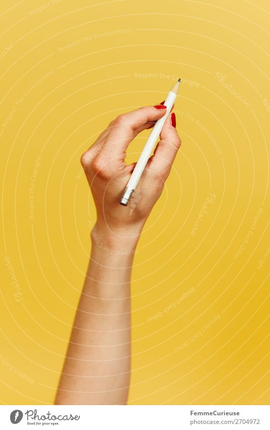Forearm and hand with pencil against a yellow background Feminine 1 Human being Communicate Design Yellow Write Draw Pencil Hand Underarm Fingers Joint