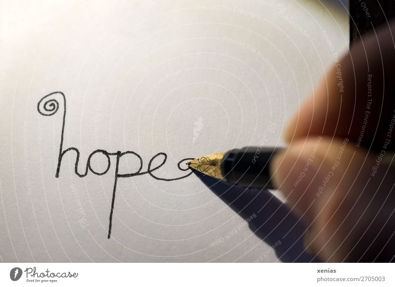 hope - handwritten with pen on white paper Hope by hand Fingers Thumb Fountain pen Pen Stationery Paper Characters Write Gold Black White Emotions Studio shot