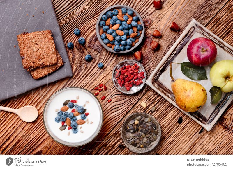 Breakfast on table. Yogurt with added blueberries and almonds Food Yoghurt Dairy Products Fruit Apple Grain Bread Dessert Nutrition Eating Lunch Organic produce