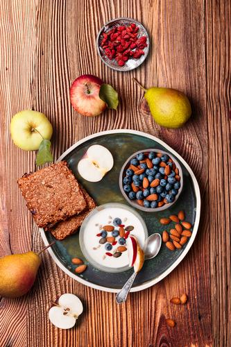 Breakfast on table. Yogurt with added blueberries and almonds Food Yoghurt Dairy Products Fruit Apple Grain Bread Dessert Nutrition Eating Lunch Vegetarian diet