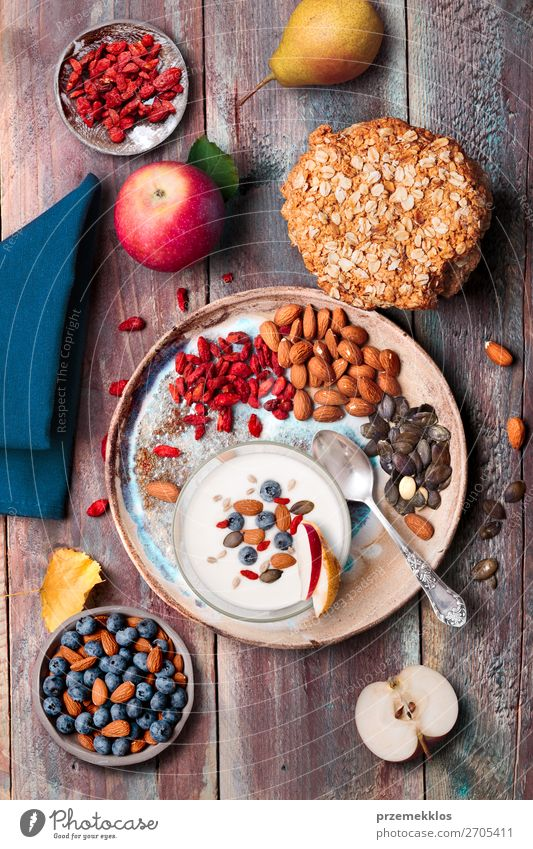 Breakfast on table. Yogurt with added blueberries and almonds Healthy Eating Food Lifestyle Wood Natural Fruit Above Nutrition Fresh Vantage point Table