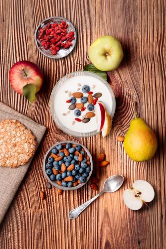 Breakfast on table. Yogurt with added blueberries and almonds Food Yoghurt Dairy Products Fruit Apple Bread Dessert Nutrition Eating Lunch Vegetarian diet Diet