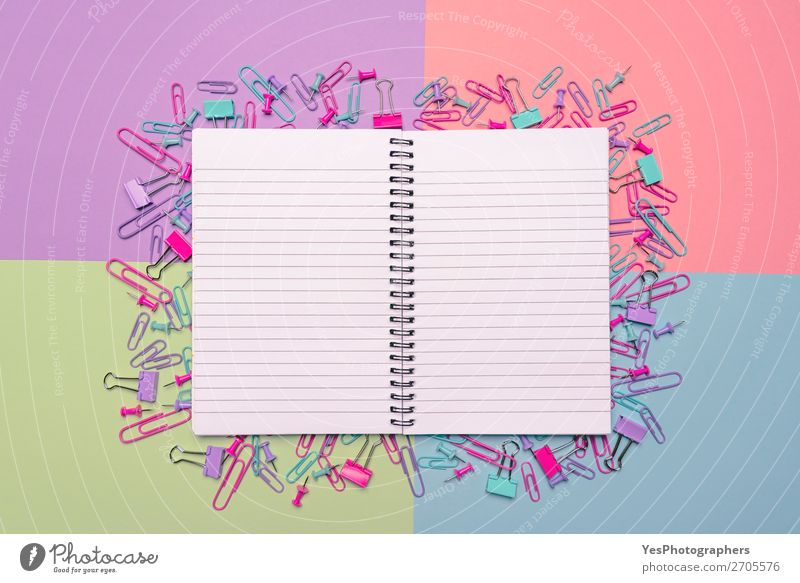 Open notebook and colorful office supplies on a desk Joy Desk Profession Workplace Office Business Career Paper Happiness Blue Green Pink Colour above view