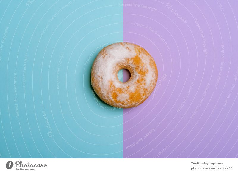 Single donut on blue-violet background. Minimalist flat lay Dessert Breakfast Blue Pink above view Baking Bakery bicolored cake Confectionary Copy Space Donut