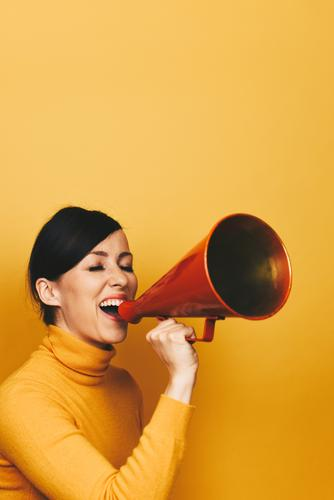 Woman making an announcement with a red megaphone Feminine Adults 1 Human being 18 - 30 years Youth (Young adults) 30 - 45 years Communicate Megaphone Scream