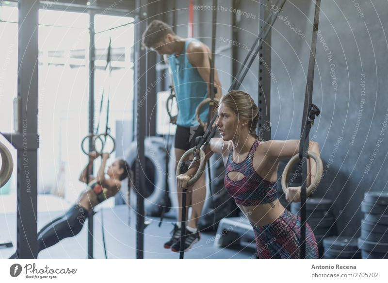 People training in gym olimpic rings and chin bar Sports Fitness Sports Training Track and Field Sportsperson Sports team Human being Woman Adults Man Ring